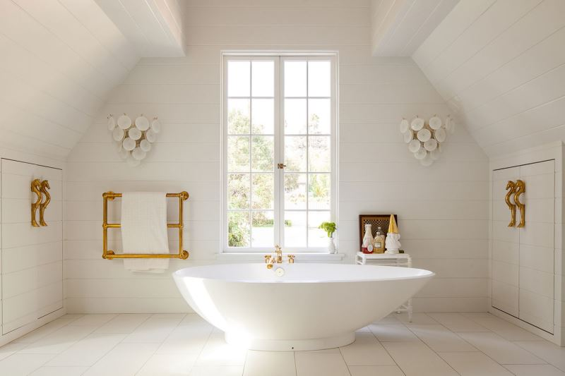 White bathroom with brass details