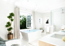 White bathroom with luxe seating