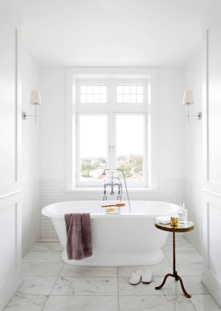 White bathroom with subway tile and marble tile