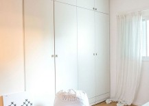White wardrobes in the bedroom become one with the backdrop