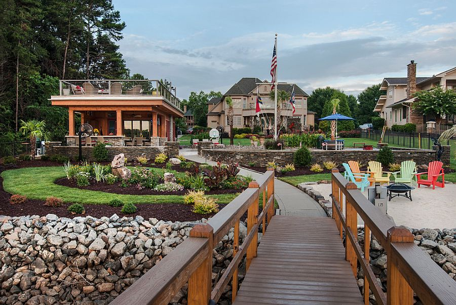 Winding walkway and bridge leads from the cabana to the lake Luxurious Lakeside Cabana: Relaxing Retreat with Scenic Splendor