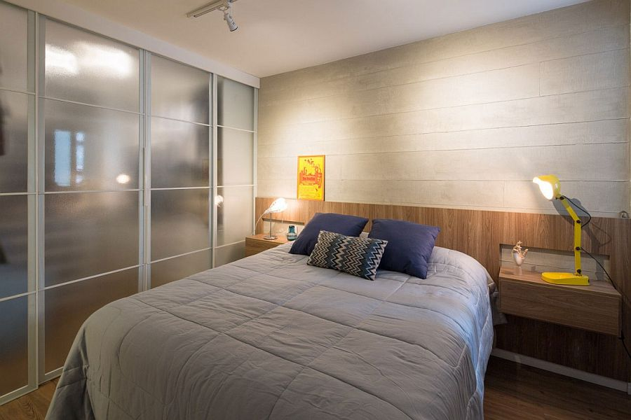 Wooden accent wall inside the contemporary bedroom