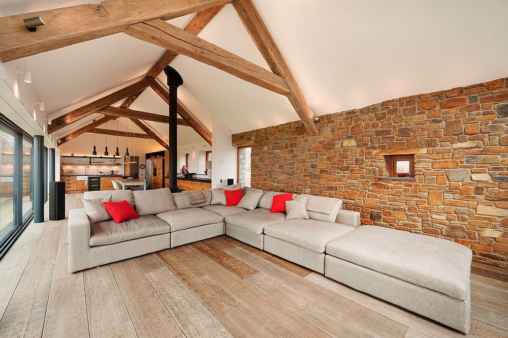 Wooden beams create a common visual across the open plan living [Design: Trewin Design Architects]