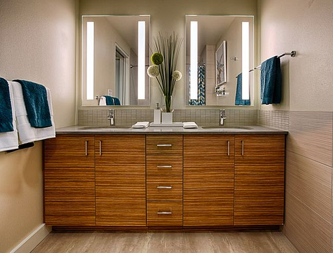 Wooden vanity in the bathroom with lovely lighting above