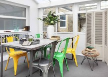 A-blend-of-colorful-chairs-is-a-trendy-choice-in-the-dining-room-217x155