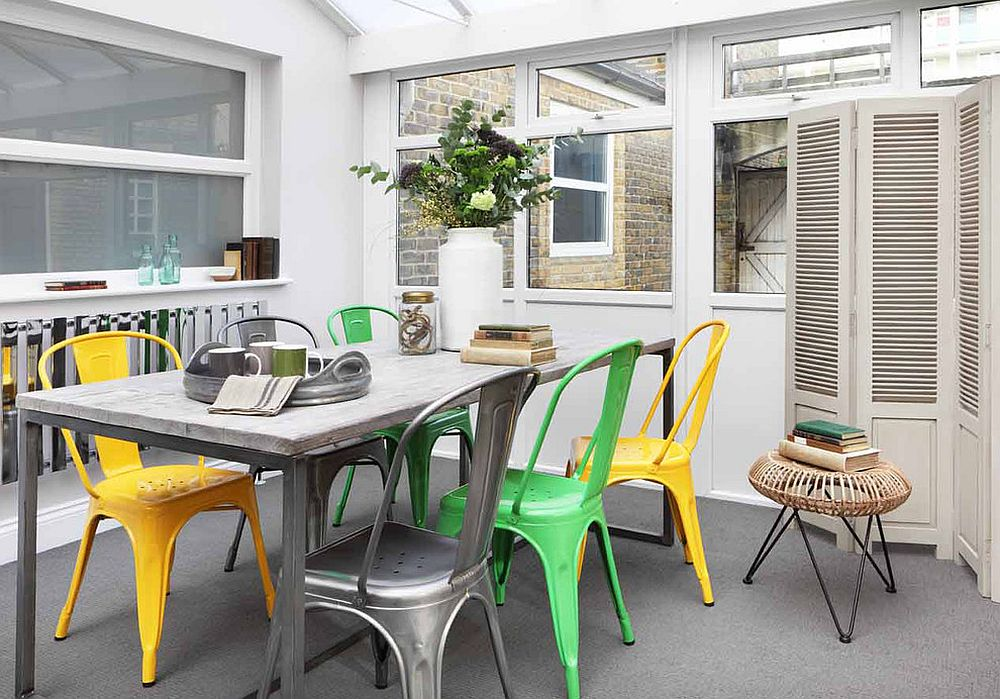 blend of colorful chairs is a trendy choice in the dining room