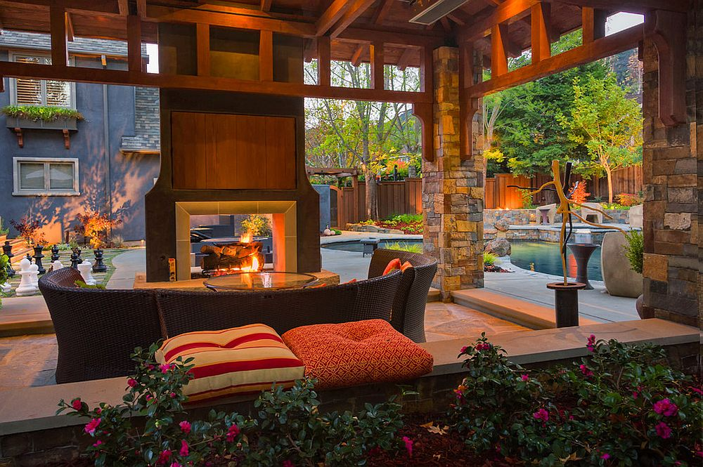 Sizzling style how to decorate a stylish outdoor hangout for Back to back indoor outdoor fireplace
