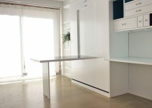 A-fold-down-desk-that-becomes-part-of-the-wall-217x155