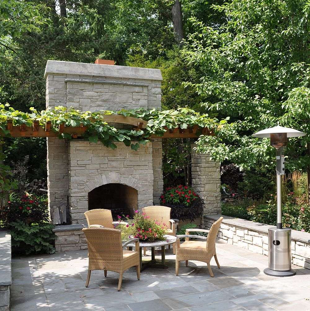 A simple pergola structure covered in vine offers ample shade for the outdoor living area [Design: Milieu Design / Photography: Peter Wodarz]