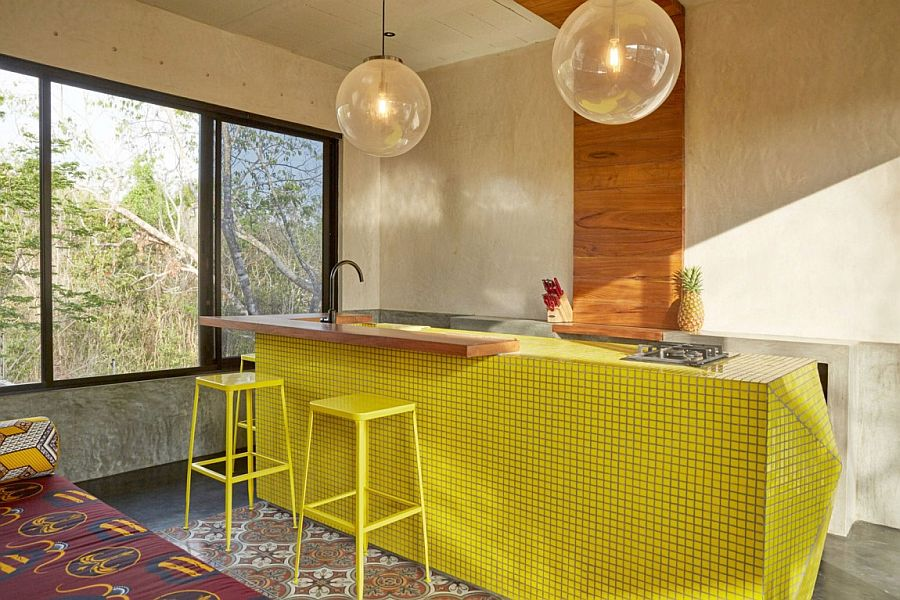 A splash of yellow revitalizes the kitchen island