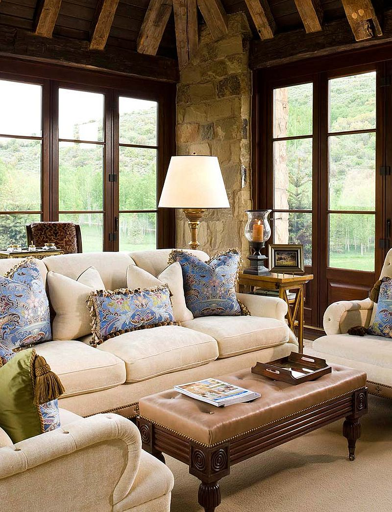 Accent pillows in blue add color to the rustic family space