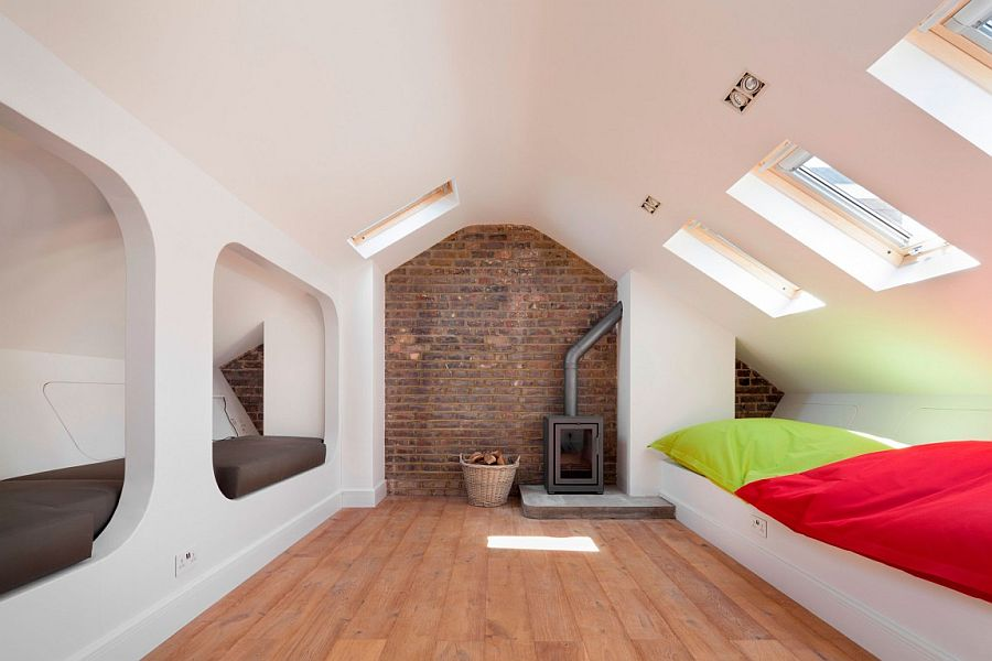 Ample space for guests in the loft with brick wall backdrop