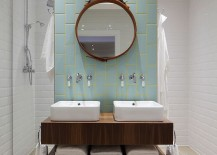 Aqua and yellow add subtle color to the stylish bathroom