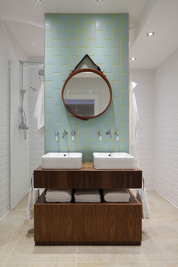 Aqua and yellow add subtle color to the stylish bathroom  Design   Oliver Burns. Trendy Twist to a Timeless Color Scheme  Bathrooms in Blue and Yellow