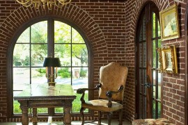 Arched windows and brick walls give the home office a traditional and timeless look