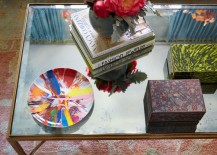 Artful objects on a mirrored coffee table