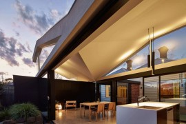 Asymmetrical butterfly roof brings in natural light