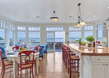 Beach style kitchen and dining with pops of bright color