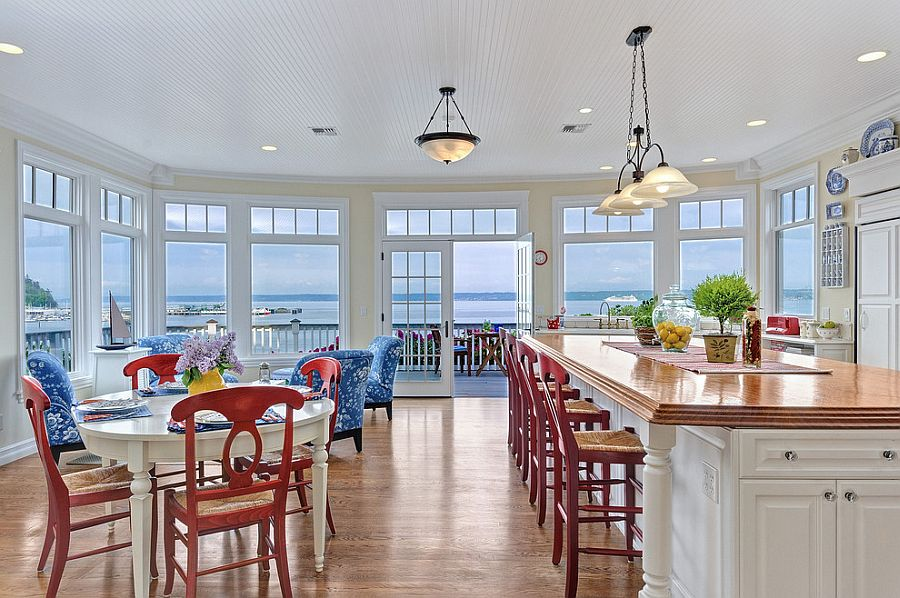 Beach style kitchen and dining with pops of bright color [Design: Eric Gedney]