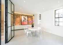 Beautiful dining room in white with an exposed brick wall as accent feature