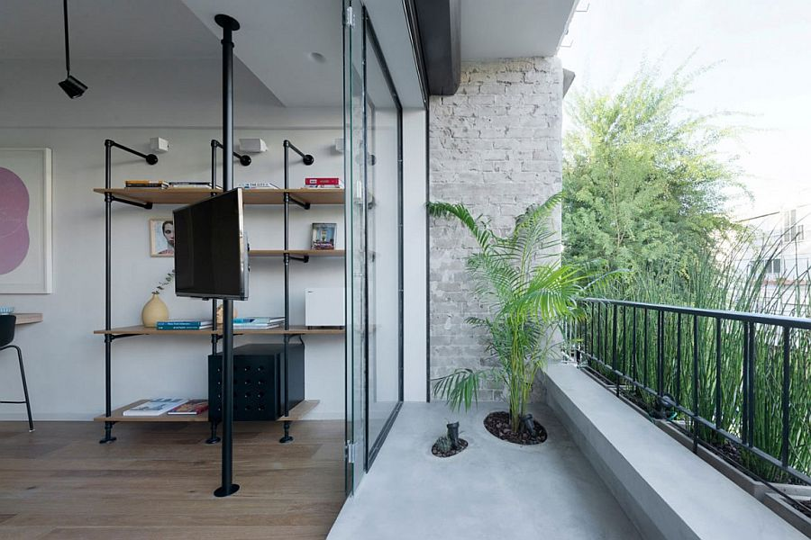 Beautiful little balcony of small apartment extends the living space outdoors
