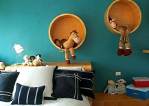 Beautiful, round wooden shelves steal the show in this kids' room