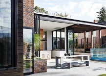 Bi fold glass doors open up the kitchen and dining area towards the rear yard 217x155 Sophisticated Fusion of Styles Amaze Inside Revamped Victorian Home