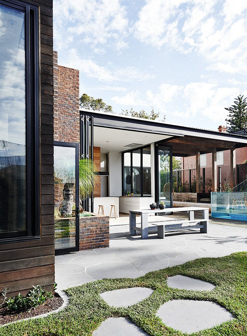 Bi-fold glass doors open up the kitchen and dining area towards the rear yard