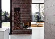 Brick fireplace in the new living space pays tribute to the original Victorian home