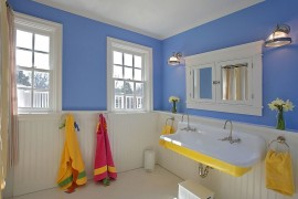 Blue and white bathroom with sink in yellow