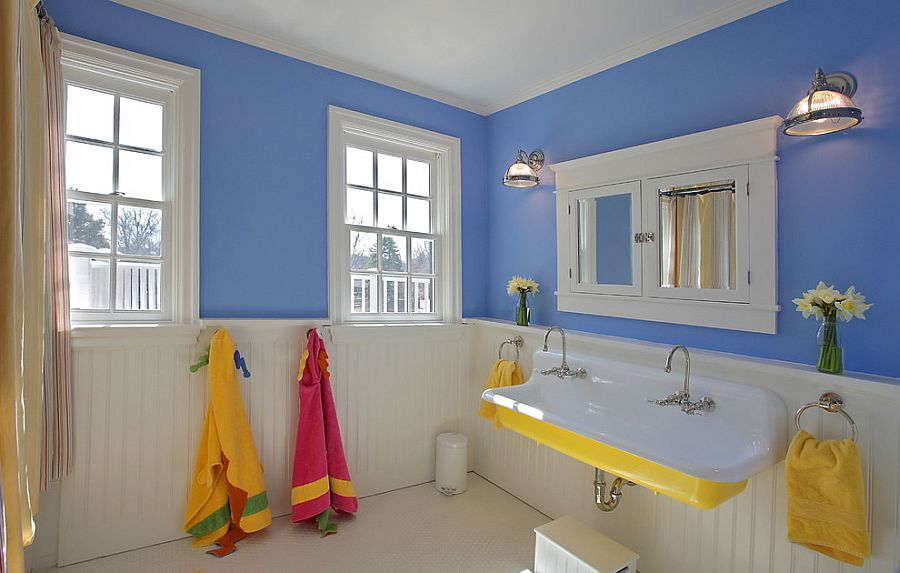 Blue and white bathroom with sink in yellow [Design: The Block Builders Group]