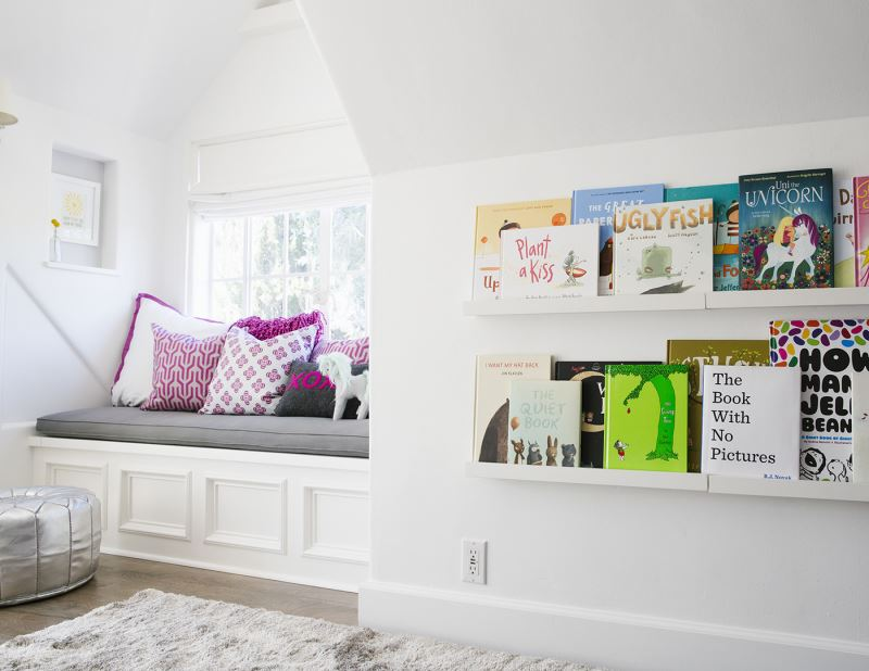 Book display shelves in a child's bedroom