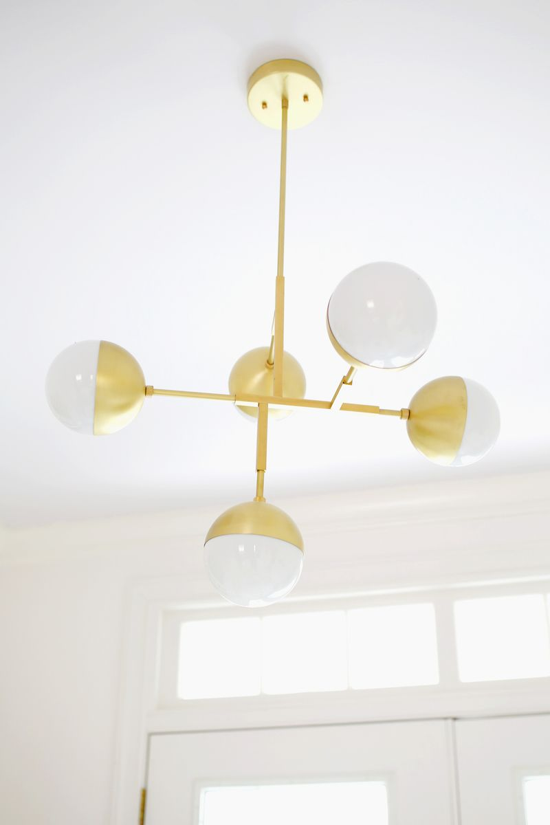 Brass lighting in the breakfast nook of blogger Elsie Larson