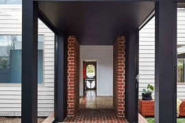Brick and glass tunnel connects the old and new structures at this revamped Aussie Residence