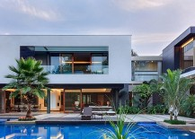 C shaped design of the house creats a natural private courtyard 217x155 Tranquil Opulence: Lavish Home in New Delhi Puts Nature Center Stage