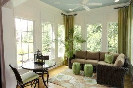Chinese stools, drapes and house plant add greenery to the cool sunroom with Asian style