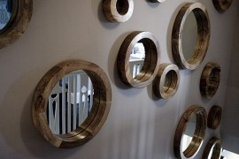 Circular mirror collection for the stairway wall