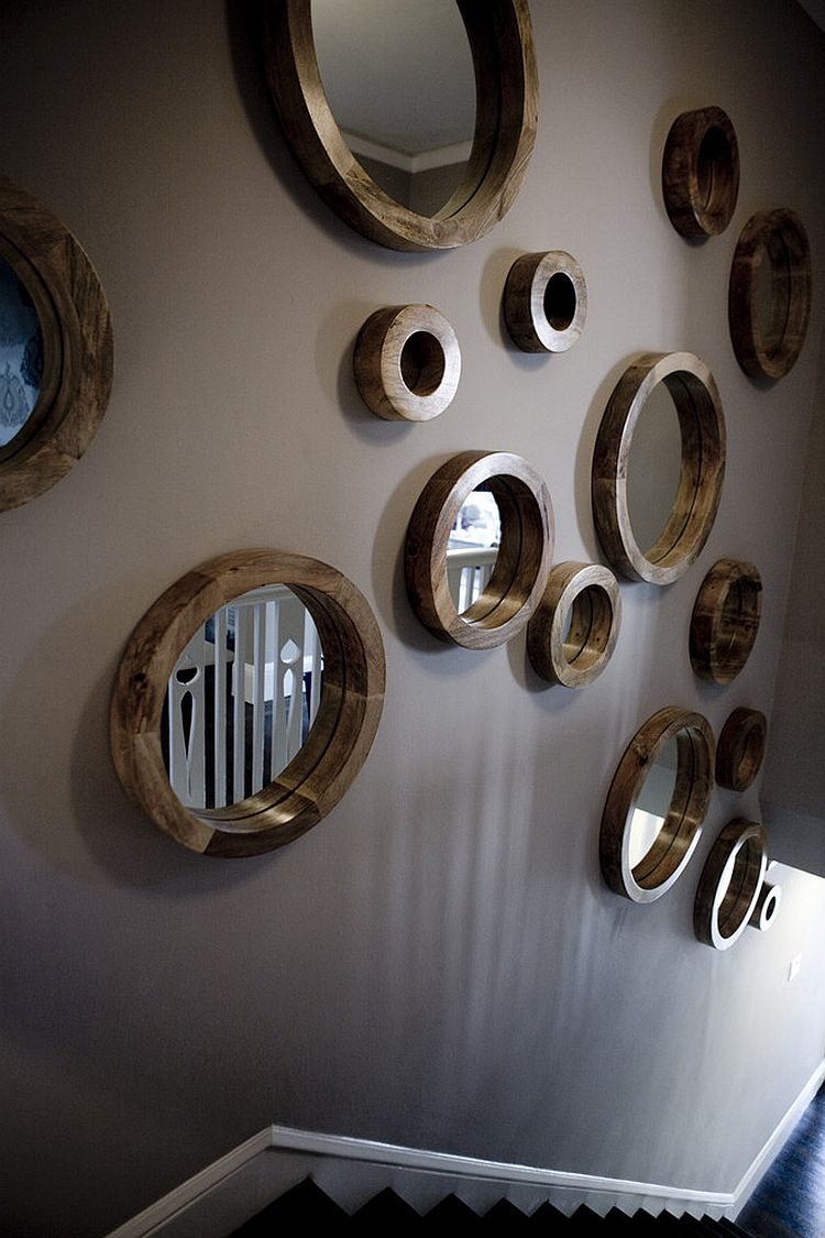 Circular mirror collection for the stairway wall [Design: Amoroso Design]