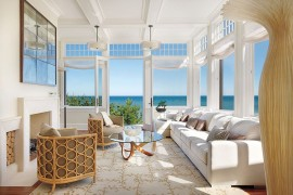 Classy beach style sunroom with in swing French doors