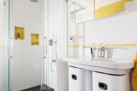 Clean bathroom with a sleek shower head