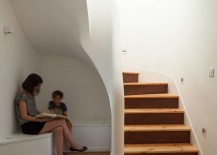 Clever-reading-and-storage-nook-under-the-staircase-217x155