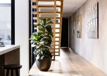 Cleverly-placed-indoor-plant-adds-color-to-an-otherwise-neutral-interior-217x155