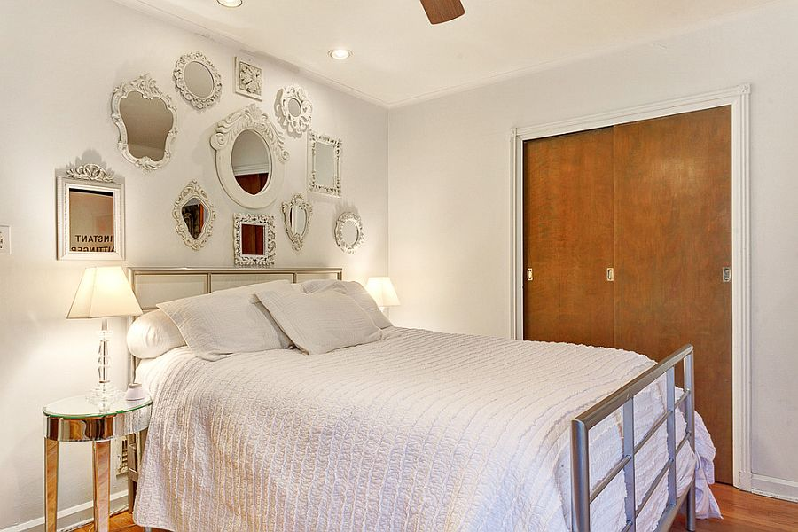 Collection of mirrors turns the headboard wall into the focal point of the room [Design: GRT Group]