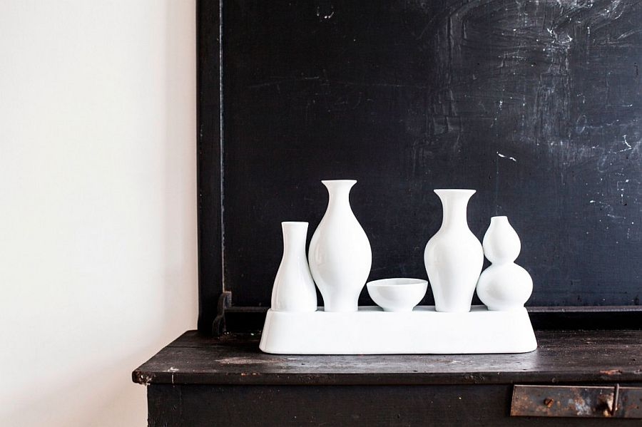 Collection of white vases set against a black backdrop