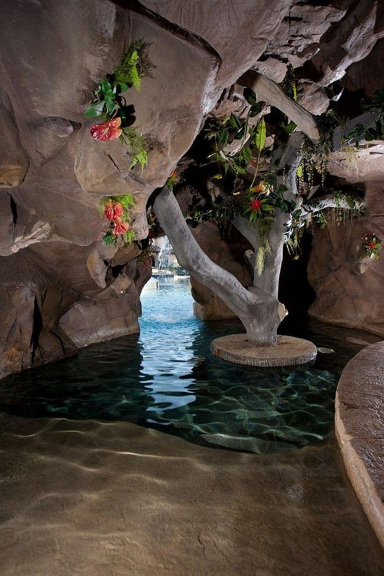 Concealed cave-styled next to the pool is the perfect way to complete your backyard paradise [Design: Marquise Pools]