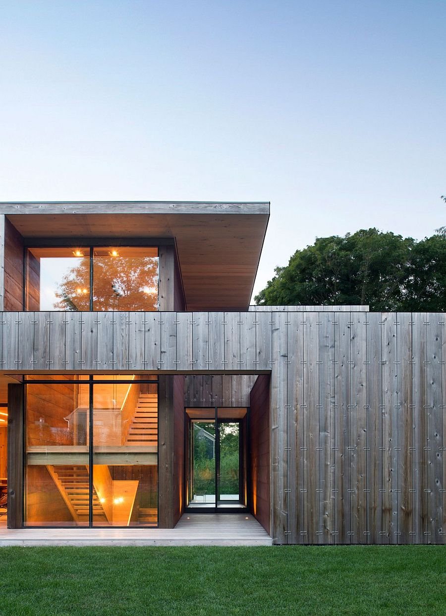 Concrete walls with felt panel and cedar boards offers a quiet and peaceful modern home