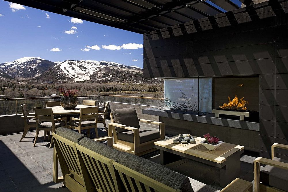 Consider the view outside before planning a cool outdoor living space with fireplace [Design: b+g design]