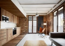 Contemporary ergonomics are coupled with original exposed brick walls and tiles surfaces 217x155 Holiday apartments in Borne: Barcelona's Rich Heritage Repackaged in Style