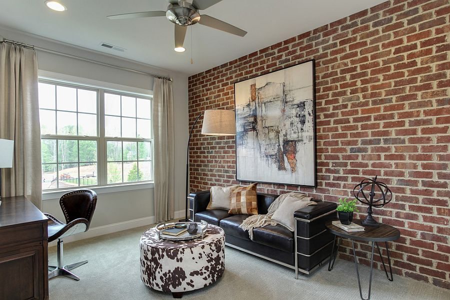 Contemporary home office with brick wall and striking wall art [Design: John Wieland Homes and Neighborhoods]