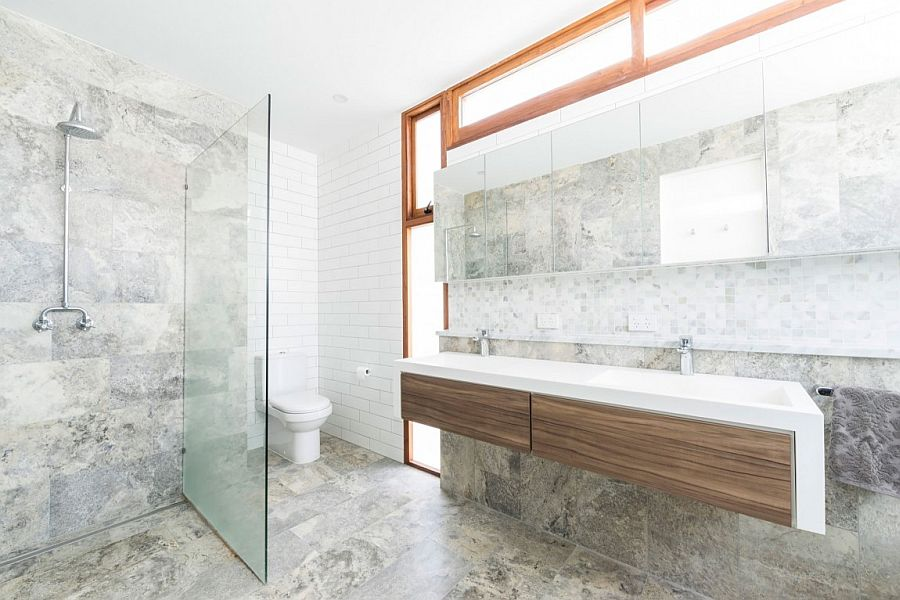 Contemporary, minimal bathroom design in stone with a bespoke vanity
